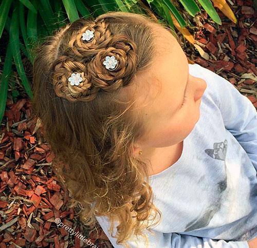 Прическа плетеные гнезда для маленькой девочки